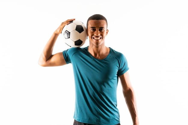 Homme de joueur de football afro-américain sur blanc isolé Photo Premium