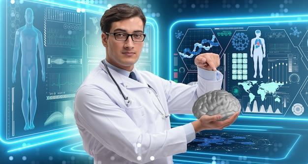 Homme médecin tenant un cerveau Photo Premium
