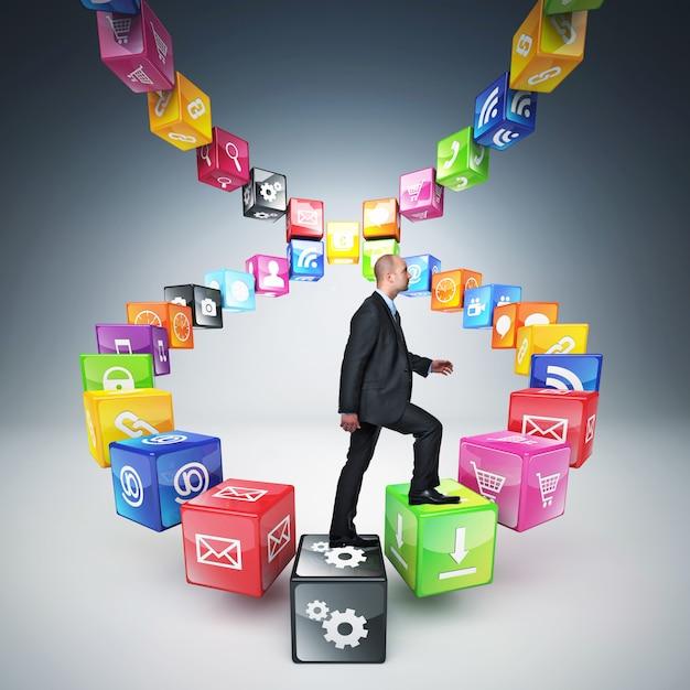 L'homme monte l'échelle faite avec des cubes et des icônes de couleurs différentes Photo Premium