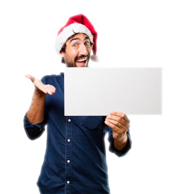 L'homme en montrant une affiche Photo gratuit