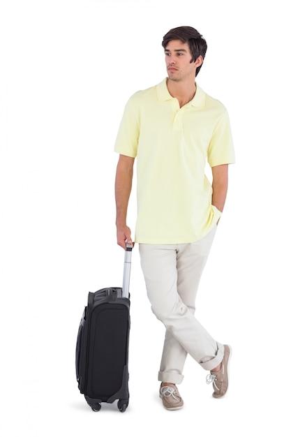 Homme pensif debout avec sa valise Photo Premium