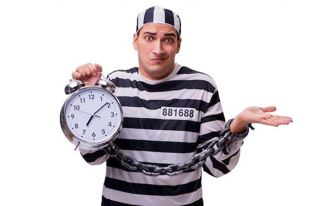 Homme prisonnier avec horloge isolé sur blanc Photo Premium
