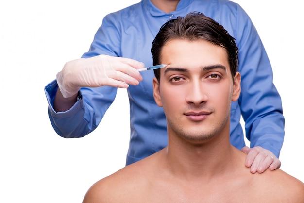 Homme subissant une chirurgie plastique isolée on white Photo Premium