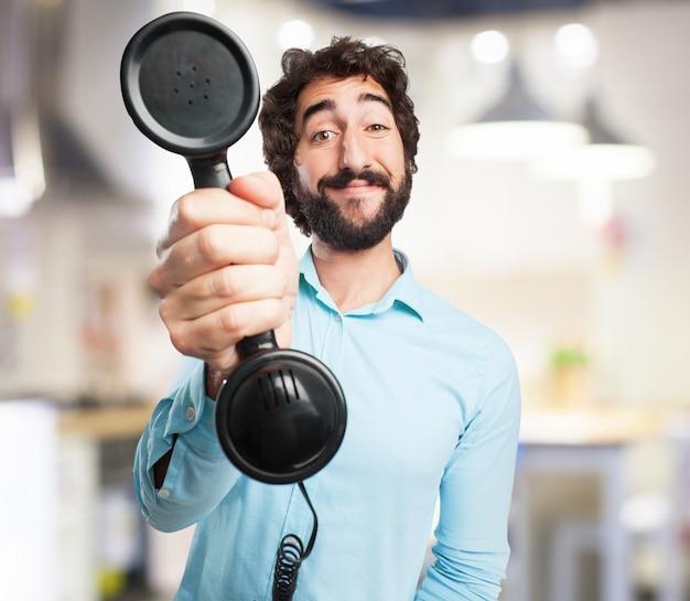 L'homme avec un téléphone vieux Photo gratuit