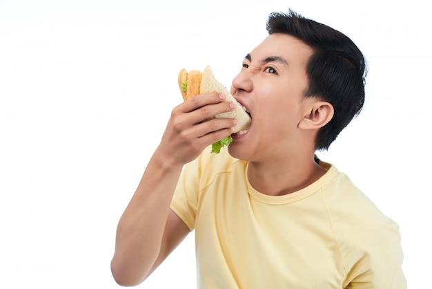 Homme très affamé Photo gratuit