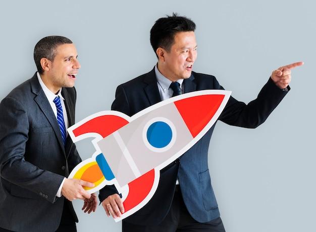 Hommes affaires, tenue, lancement, fusée icône Photo gratuit