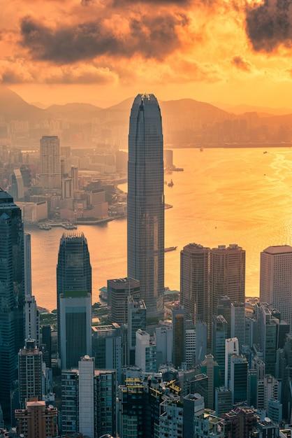 Hong Kong City Skyline At Sunrise View From Peak Mountain. Photo Premium
