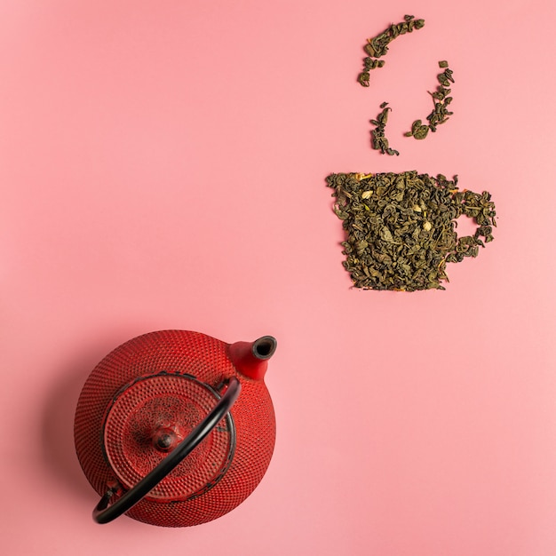 Icône de tasse de thé faite de feuilles de thé sèches oolong Photo Premium