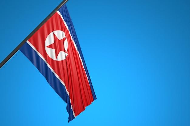 Illustration Du Drapeau National De La Corée Du Nord Sur Un Mât En Métal Flottant Contre Le Ciel Bleu Photo Premium
