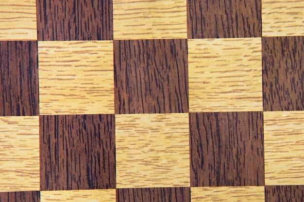 Image macro de l'échiquier pour papier peint marron Photo Premium