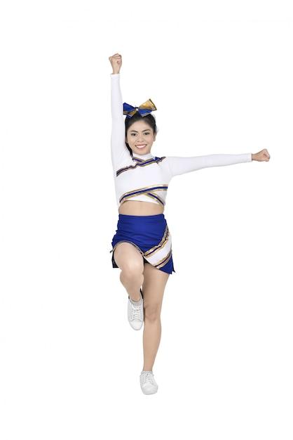 Images de pom-pom girl asiatique effectuant avec costume blanc et bleu Photo Premium