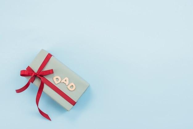 Inscription de papa avec boîte-cadeau Photo gratuit