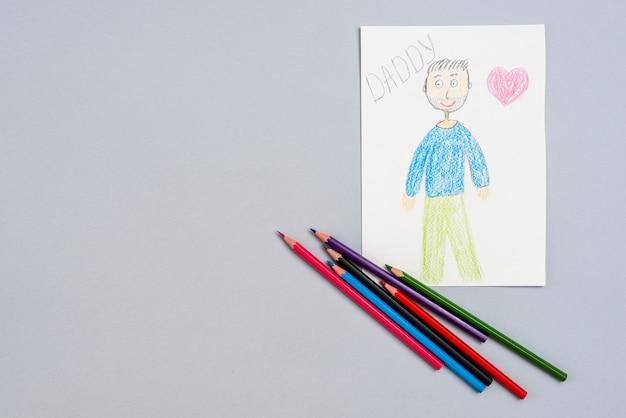 Inscription de papa avec dessin de l'homme et crayons Photo gratuit