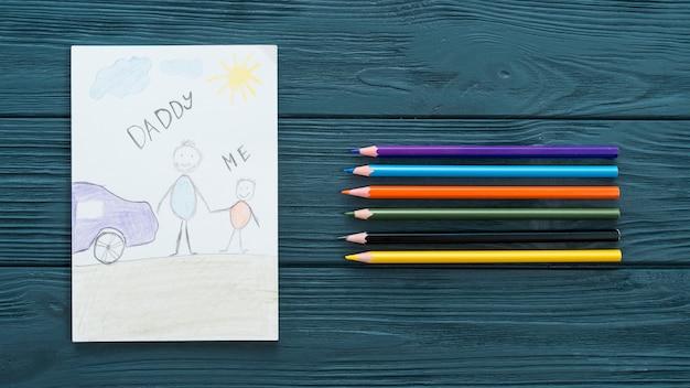 Inscription papa et moi avec des crayons de couleurs Photo gratuit