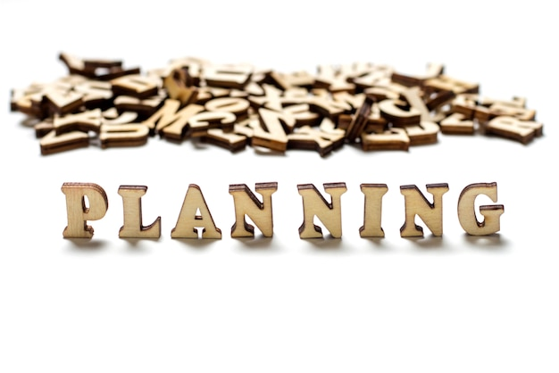 Inscription planning écrit lettres en bois close-up, le concept de planification Photo Premium