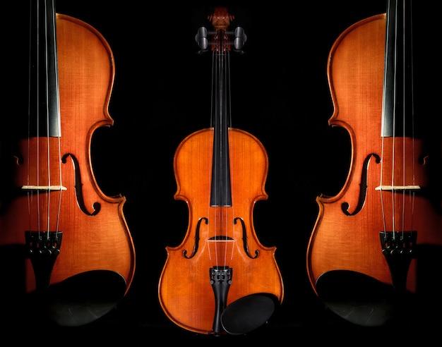 Instruments de musique closeup violon orchestra sur fond noir Photo Premium