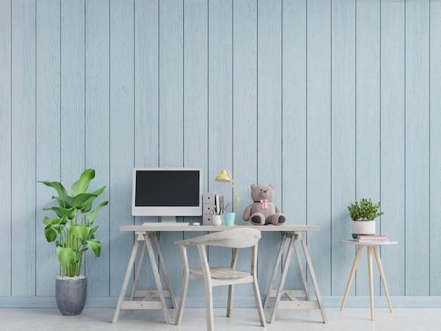 Intérieur de bureau à la maison moderne avec des murs bleus décoré d'ours en peluche sur la table. Photo Premium