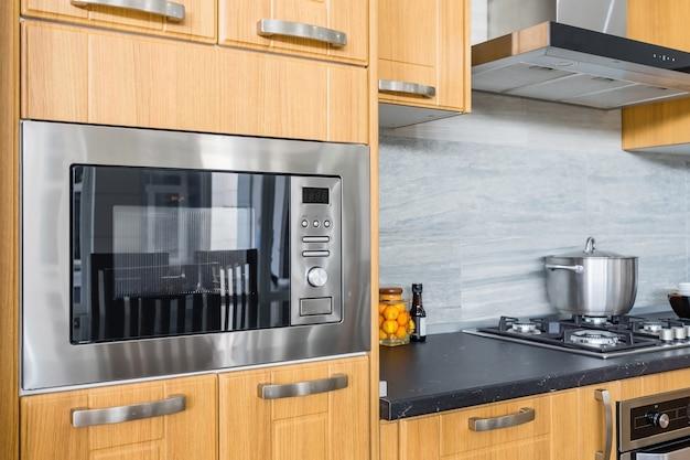 Intérieur de cuisine moderne avec four neuf Photo Premium