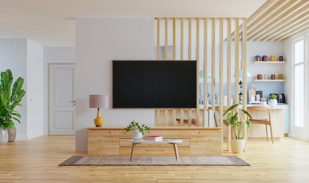 Intérieur De Cuisine Moderne Avec Des Meubles Et Tv Fixé Au Mur Dans Un Salon Avec Un Mur Blanc. Photo Premium