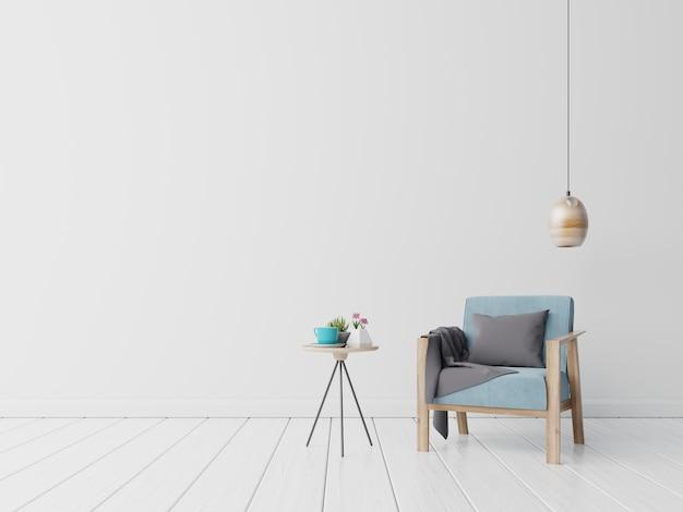 L'intérieur a un fauteuil bleu et fleur, lampe, table sur fond de mur blanc vide Photo Premium