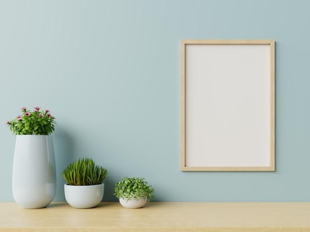 Intérieur avec des plantes, cadre sur un mur bleu vide b Photo Premium