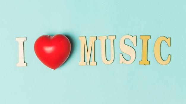 J'aime le texte de musique avec coeur rouge sur fond turquoise Photo gratuit