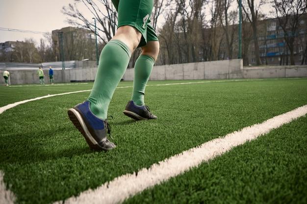 Les Jambes Du Joueur De Football Soccer Photo gratuit