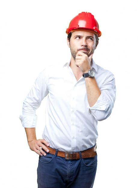 Jeune architecte travaillant sur fond blanc Photo Premium
