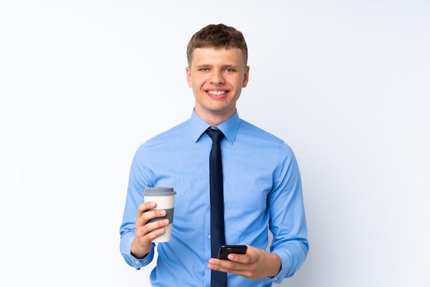 Jeune bel homme d'affaires sur fond blanc isolé Photo Premium