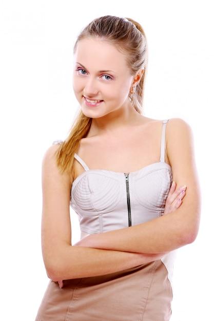 Jeune et belle fille sur le blanc Photo gratuit