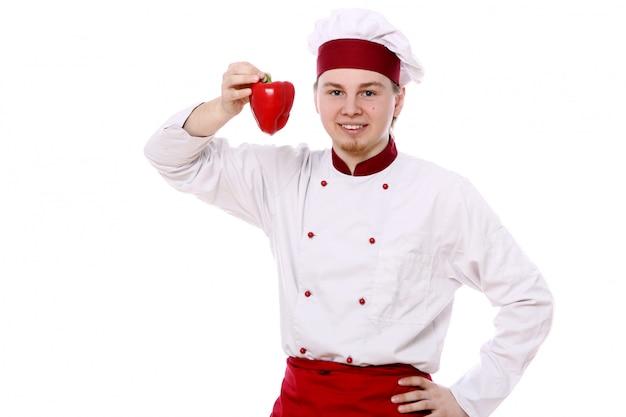 Jeune Chef Au Paprika Rouge Photo gratuit