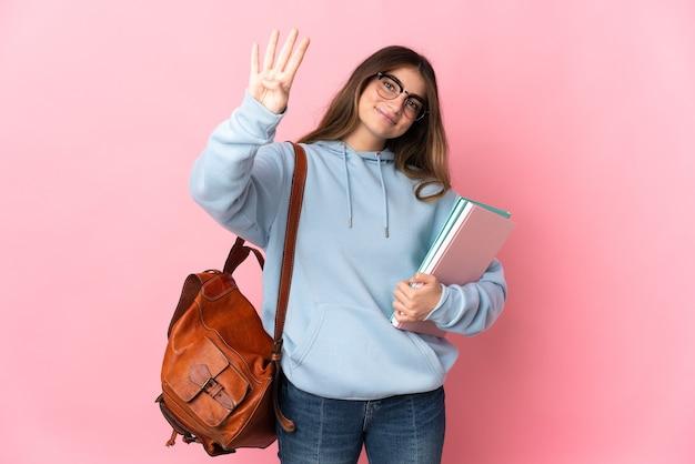 Jeune étudiante Isolée Sur Rose Heureux Et Comptant Quatre Avec Les Doigts Photo Premium