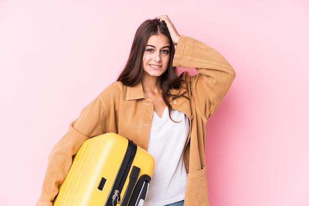 Jeune Femme Caucasienne Voyageur Tenant Une Valise Isolée étant Choquée, Elle S'est Souvenue D'une Réunion Importante. Photo Premium