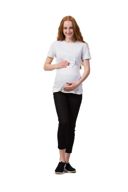Jeune femme enceinte isolée sur blanc Photo Premium