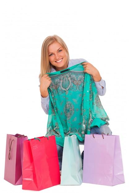 Jeune femme avec des sacs Photo gratuit