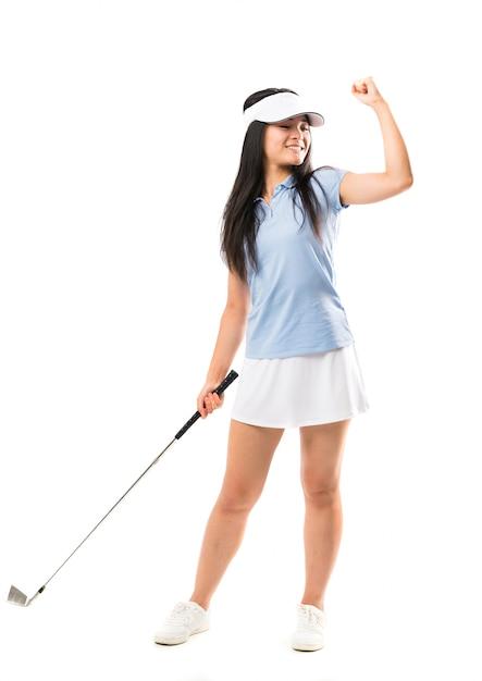 Jeune golfeuse asiatique sur un mur blanc isolé Photo Premium