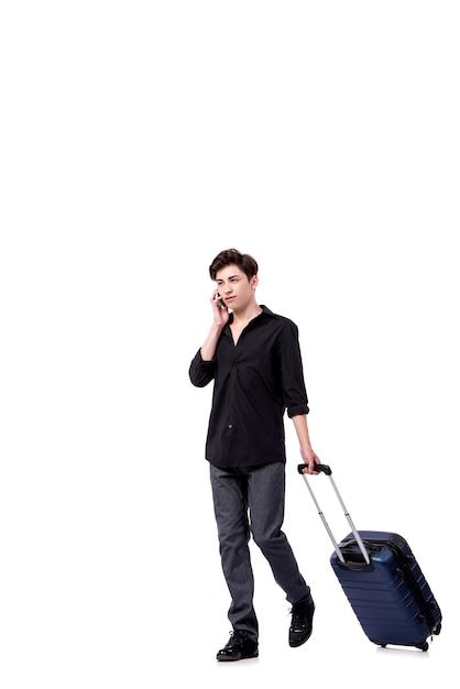 Jeune homme au concept de voyage isolé sur blanc Photo Premium