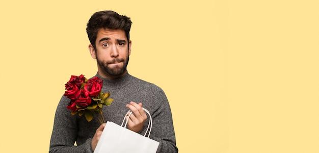 Jeune homme célébrant la saint valentin Photo Premium
