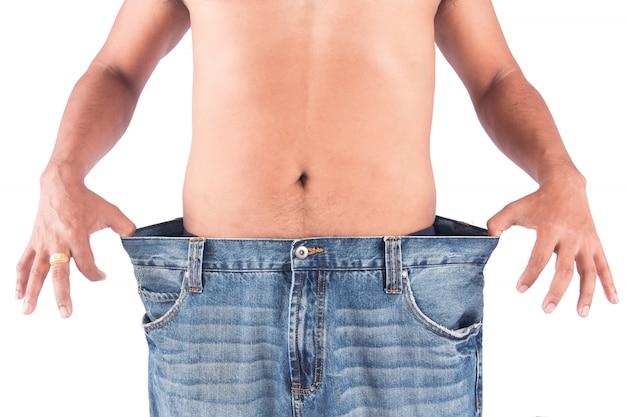 Jeune homme montrer corps après perte poids Photo Premium