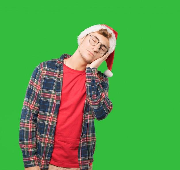 Jeune homme à noël fait des gestes Photo Premium
