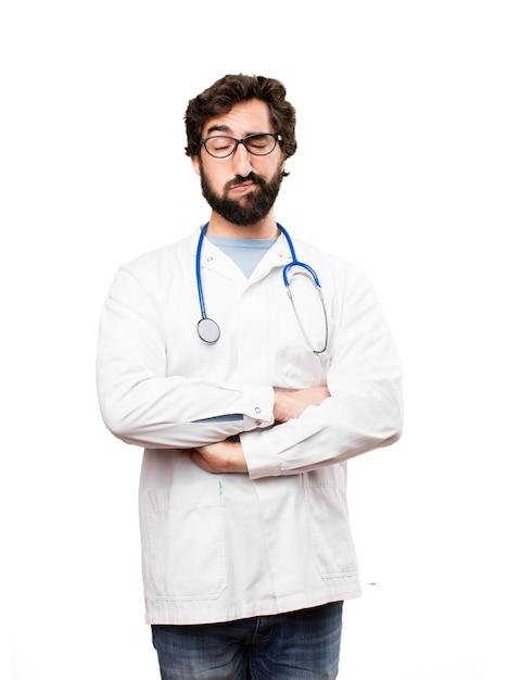 Jeune médecin homme expression ennuyeuse Photo gratuit