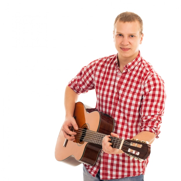 Jeune Musicien Avec Une Guitare Photo gratuit