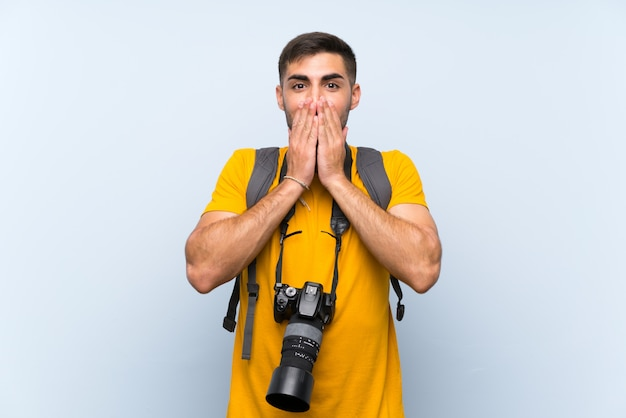 Jeune photographe avec une expression du visage surprise Photo Premium