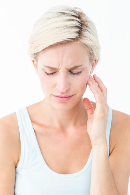 Jolie blonde avec douleur aux dents Photo Premium