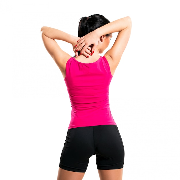 Jolie femme brune au cours de l'exercice de remise en forme Photo gratuit