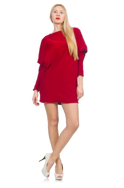 Jolie fille en robe rouge isolé sur blanc Photo Premium