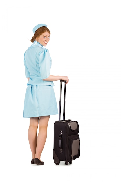 Jolie hôtesse se penchant sur la valise Photo Premium
