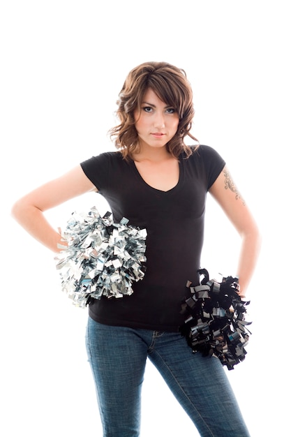 Jolie jeune femme posant avec pom-poms pom-pom girl Photo Premium