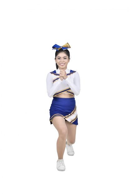 Jolie pom-pom girl asiatique en action Photo Premium