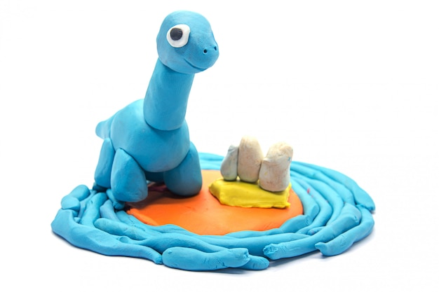 Jouer la pâte brachiosaurus sur fond blanc Photo Premium